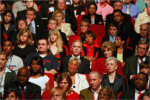 Democratic Party Chairman Howard Dean (center) looked on from the crowd at the debate.