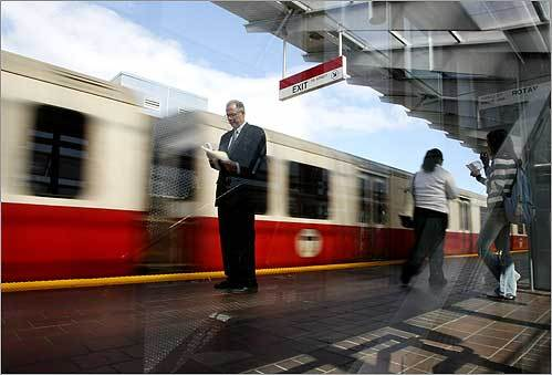 A train slowed to a stop as riders waited on the platform at the newly remodeled MBTA Fields Corner Station on Sept. 23.