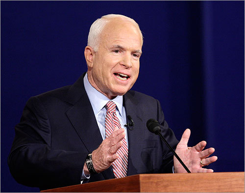 John McCain spoke during the debate. McCain put the fate of the debate up in the air this week, halting his campaign on Thursday and asking for a debate delay to return to Washington and work on the economic bailout plan. On Friday, McCain reversed course and traveled to Mississippi for the debate.