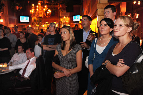 Patrons at Top of The Hill, a Capitol Hill bar, watched the debate.