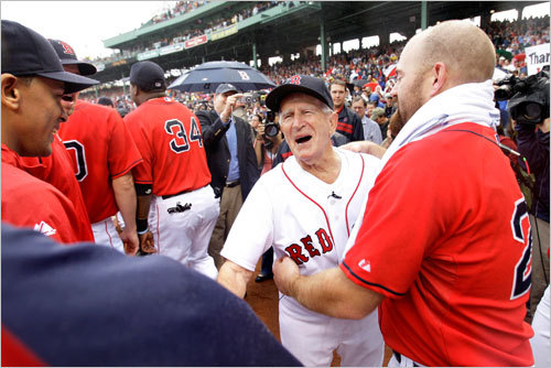 Red Sox first baseman Kevin Youkilis (right) shared a moment with Pesky.