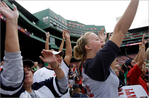 Red Sox fans cheered during a rally at Fenway Park on Monday.