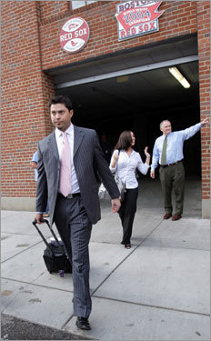 Sox ace Josh Beckett walked to the team bus outside of Fenway Park. An oblique injury is expected to keep Beckett from pitching until Game 3 of the ALDS.