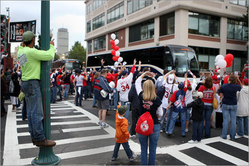 Fans waved as the team bus pulled away from Fenway.