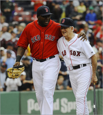 Pesky walks off the field with David Ortiz after the first pitch ceremony.