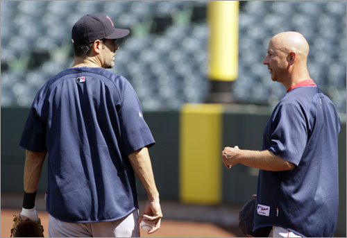 Red Sox manager Terry Francona (right) talked to third baseman Mike Lowell during a workout Tuesday afternoon in Anaheim, Calif.