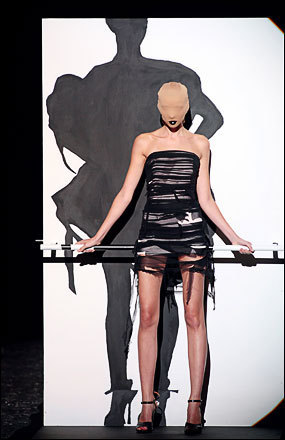 A model presents a creation by Belgian designer Martin Margiela during the Spring/Summer 2009 ready-to-wear collection show in Paris, on September 29, 2008. See more photography at Boston.com/photos