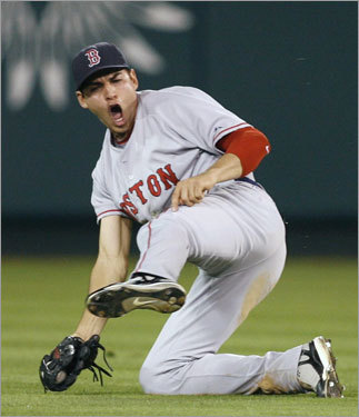 Ellsbury reacted after making a diving catch in the eighth inning.