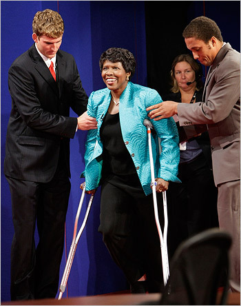 Moderator Gwen Ifill, apparently suffering from a leg injury, was helped on to the stage. Ifill, who has drawn criticism because she is writing a book with a chapter on Barack Obama, quipped, 'I fell, I wasn't pushed.'