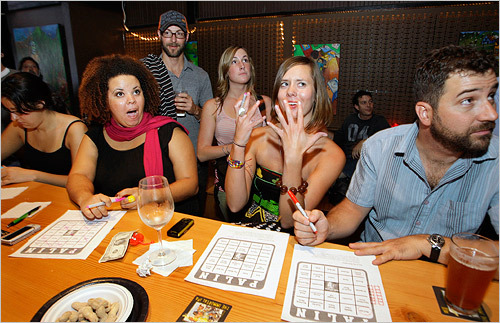 Left to right, Sarah Studer, Sylvie Ofstie and Patrick Kenney filled out 'Palin Bingo' at a debate party in Seattle.