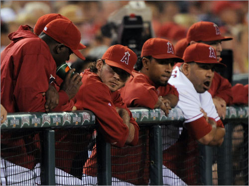 Angels reserves looked on during the first inning.