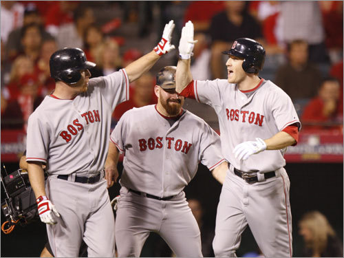 J.D. Drew (left), Kevin Youkilis (center) and Jason Bay (right) celebrated at home plate after Bay's three run homer in the first inning.