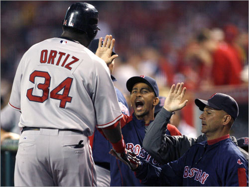 David Ortiz celebrated with teammates after scoring in the first inning.