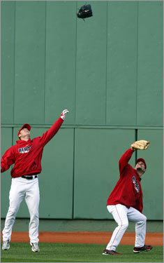 Red Sox pitcher Jon Lester (left) threw his glove at a ball as Javier Lopez (right) ducked during batting practice.