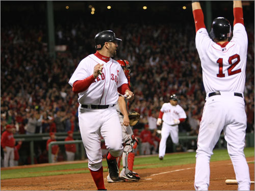Jed Lowrie (right) signaled for Jason Varitek (left) to stand up as he crossed the plate on Jacoby Ellsbury's three-run single in the second inning.