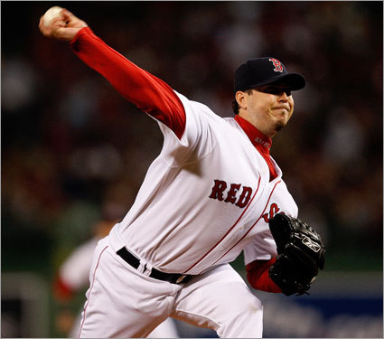 Red Sox starter Josh Beckett delivered a pitch in the first inning of Game 3 of ALDS at Fenway Park.