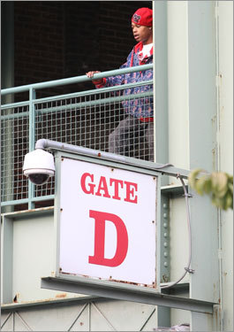 A fan looked out on Yawkey Way from inside gate D prior to Game 3 of the ALDS at Fenway Park.