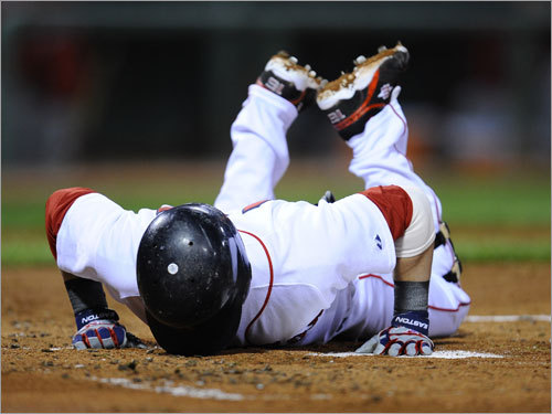 Pedroia stayed on the ground for a short time but remained in the game.