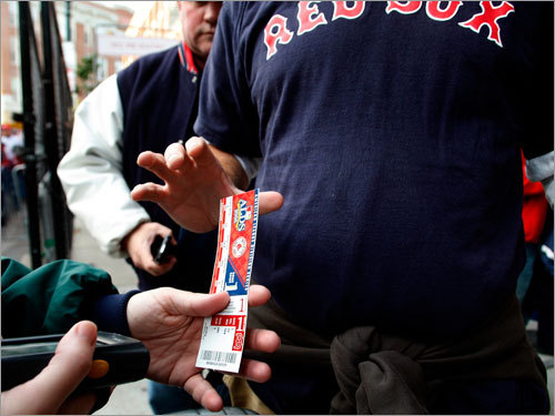 Fans had their tickets scanned at the gate on their way into Fenway Park for the start of Game 3.