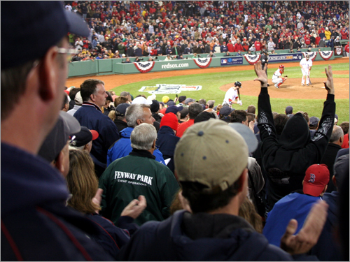 Fenway was on its feet as Kevin Youkilis stepped to the plate in the 12th inning representing the winning run. But Youk flied out, the Sox fell to the Angels 5-4 in Game 3, and fans left the park grumbling after a long game on a chilly night in Boston.