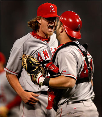 Angels starter-turned-reliever Jered Weaver and catcher Mike Napoli savor the last out.