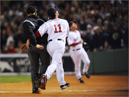 Sox first baseman Mark Kotsay (11) ran into first-base umpire Kerwin Danley while pursuing a foul ball in the second inning.