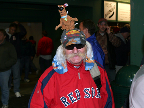 Del 'Dog Man' Christman , clubhouse manager for the Lowell Spinners, is a regular attendee at postseason games at Fenway.