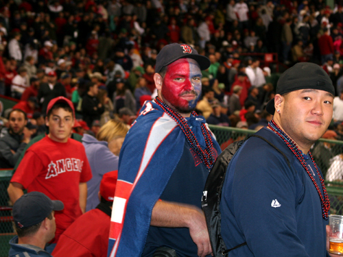 Face-painting Red Sox fan Nick Robin (left) of Brockton, who calls himself the Red Sox pope, and his friend Andy Ngo of Quincy heckled members of the Angels bullpen. Both thought the tie game would end before reaching extra innings.