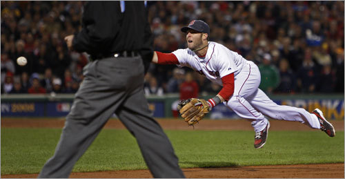 Dustin Pedroia stretched out for a flip to first that retired the side in the third inning.