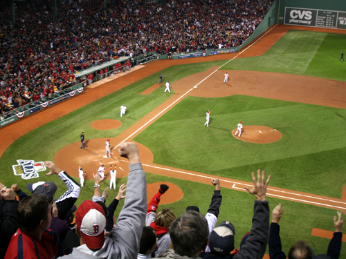 Fans in the State Street Pavilion erupt after Jacoby Ellsbury's pop single scored three runs for the Red Sox in the second inning of Game 3.