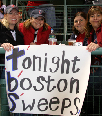 Robyn Avery, Sarah Legendre, and Karen Benedetto, all from Brookline, thought making a sign that predicted a Red Sox sweep was a good idea. Jen Griffith (right), from Norton, had a bad feeling about displaying the presumptive message from the get-go.