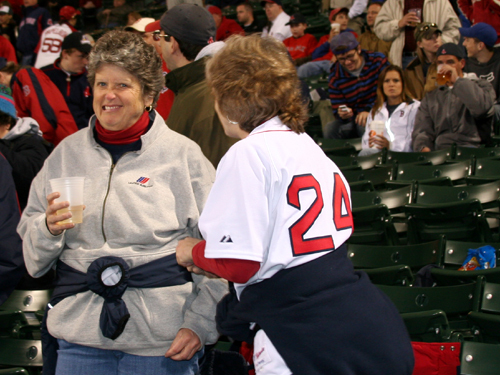 Jane McNeil (right) from Concord was looking for a No. 4 to sew over the No. 2 on her jersey. Jane and her sister Anne hope the Dodgers make it to Fenway for the World Series to 'let Manny know how we feel about him now.'