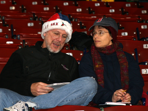 Joshua Boger of Concord,and his wife Amy bundled up for a cold night at Fenway. Joshua keeps score for each game he attends and had the results of Josh Beckett's 2007 World Series Game 1 win penciled in his scorebook.