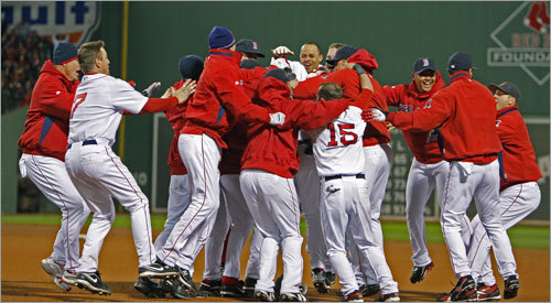 The mob came together around Lowrie (center, hidden) after his series-clinching single.