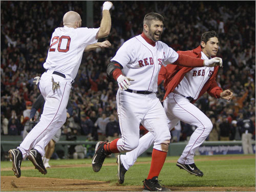 Kevin Youkilis (left), Jason Varitek (center), and Jacoby Ellsbury (right) rushed to revel with teammates.