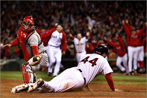 . . . The throw arrived late, and the Red Sox bench emptied after Bay (44) slid past the tag of Angels catcher Mike Napoli with the winning run.
