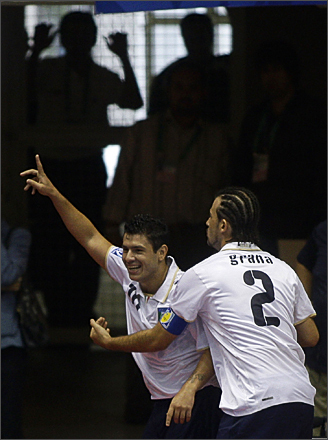 See more photography at Boston.com/photos Italy's Adriano Foglia, left, celebrates with teammate Grana after scoring a goal against the US during a FIFA Futsal World Cup 2008 match in Rio de Janeiro, Thursday, Oct. 2, 2008.
