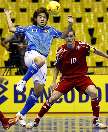 See more photography at Boston.com/photos Cuba's player Isven Roman looks as Japan's Kotaro Inaba controls the ball during a FIFA Futsal World Cup Brazil 2008 match, held in Brasilia on October 06, 2008.