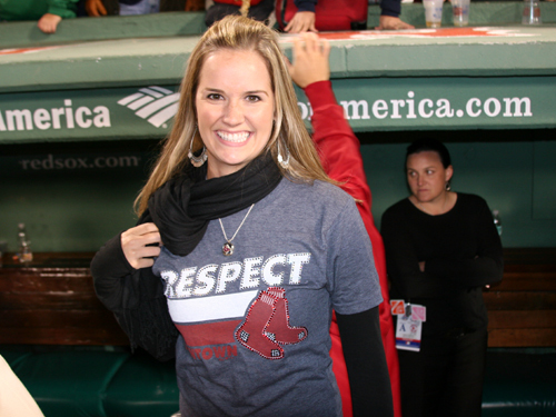 Kelsey Hopkins shows off her Respect Beantown shirt during the postgame celebration.