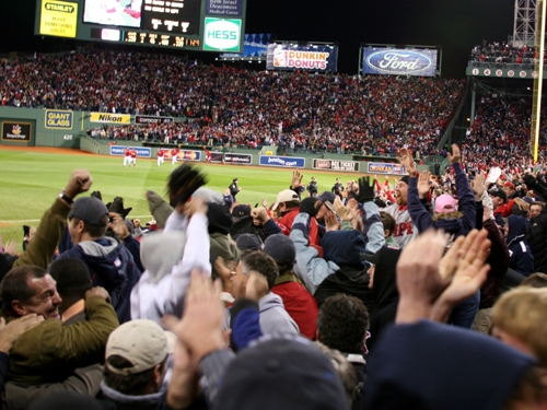 Fans congratulate each other as the Red Sox advance to the ALCS on a walkoff win over the Angels.