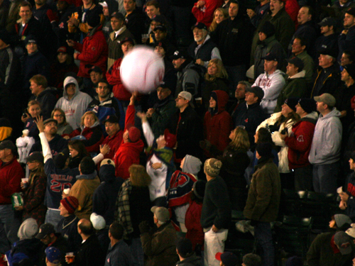 Bleacher fans were successful in getting a Red Sox beach ball batted around on a cold night.