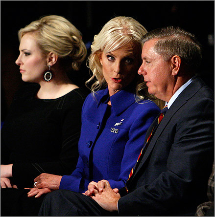 McCain's wife Cindy (middle) spoke to Senator Lindsay Graham of South Carolina (right) before the debate.