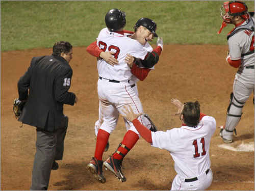 Bay was greeted at the plate by Sox catcher Jason Varitek (33) as Mark Kotsay (11) rushed in.