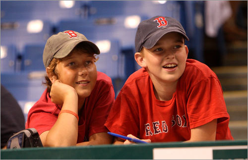 Red Sox fans Chris Chiavaroli (left) and Andrew English, both of Fort Lauderdale, waited for the Red Sox to take batting practice before Game 1 of the ALCS between the Red Sox and Rays at Tropicana Field in St. Petersburg, Fla. on Friday.