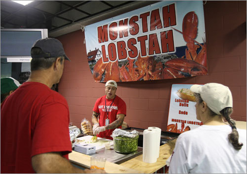 Allen Berube served lobster rolls before Game 1 at the Trop. Berube, who is originally from Biddeford, Maine, owns a restaurant -- Monstah Lobstah in Tampa -- and has four lobster roll stands at Tropicana Field.