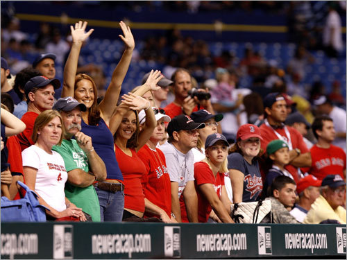 Red Sox fans lined the dugouts trying to catch a glimpse of their favorite players before the game.