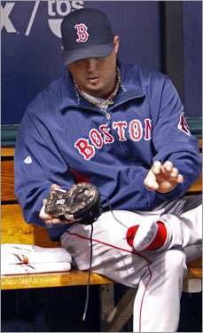 Game 2 starter Josh Beckett put on his cleats in the dugout before the game.