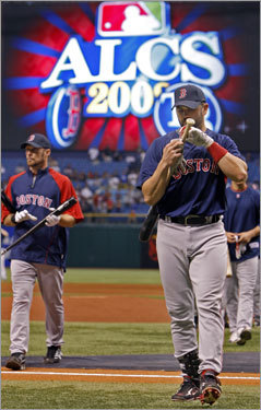 Red Sox catcher Jason Varitek (right) and first baseman Mark Kotsay (left) walked the field before the game.