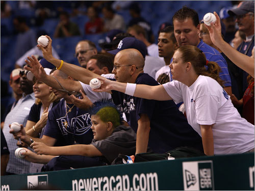 Fans attempted to get autographs from players during warmups.