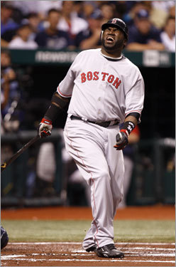 Red Sox DH David Ortiz reacted after fouling a ball off of his leg in the first inning of Game 2 of the ALCS.